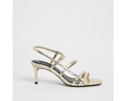 Golden metallic strappy strappy sandals with high heels